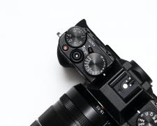 close up, top view of a Fuji mirrorless camera.